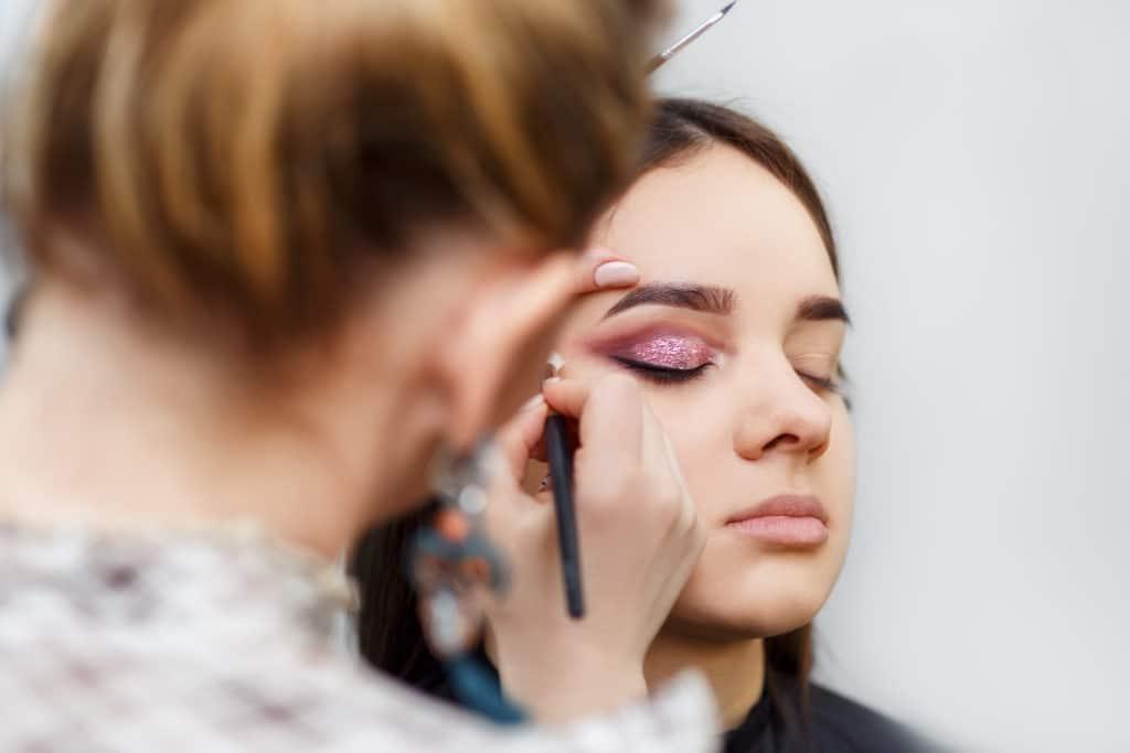 makeup artist doing glamour makeup